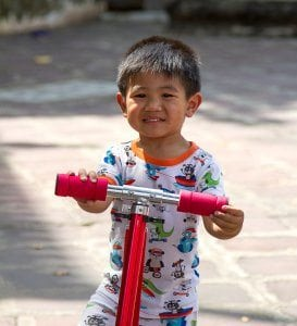 toddler-on-red-scooter