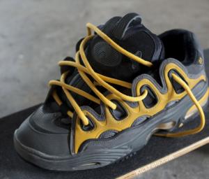 black and yellow wide skateboarding shoes