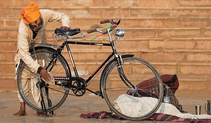 Man cleaning a bike