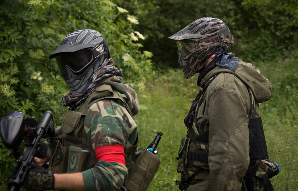 2 person wearing paintball gear